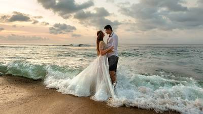 Giant wave ruins newlyweds oceanside picture