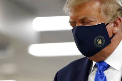 Trump visits Walter Reed Medical Center, wears mask in public for first time
